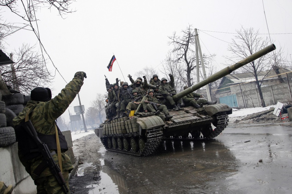 epa04576078 Armed pro-Russian rebels ride a tank in downtown Donetsk, Ukraine, 22 January 2015. Tensions in eastern Ukraine surged following reports that many civilians had been killed in an explosion at a bus stop in Donetsk. Separatist-run news sites said that 13 people died and more than 20 were injured when a grenade exploded as passengers were boarding a trolleybus. The Kiev-loyal authorities put the number of dead at eight.  EPA/ALEXANDER ERMOCHENKO