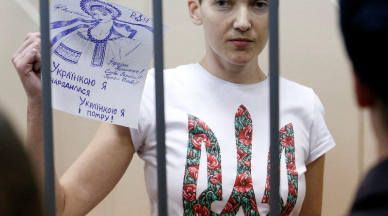 "Ukrainian army pilot Nadezhda (Nadia) Savchenko holds a sign inside a defendants' cage as she attends a hearing at the Basmanny district court in Moscow February 10, 2015. A Moscow court extended on Tuesday the detention of Nadezhda Savchenko, a Ukrainian army pilot being held on charges of aiding the killing of two Russian journalists in east Ukraine last year. The sign reads, ""I was born Ukrainian, and I die Ukrainian"". REUTERS/Maxim Zmeyev (RUSSIA - Tags: CRIME LAW POLITICS CONFLICT)"